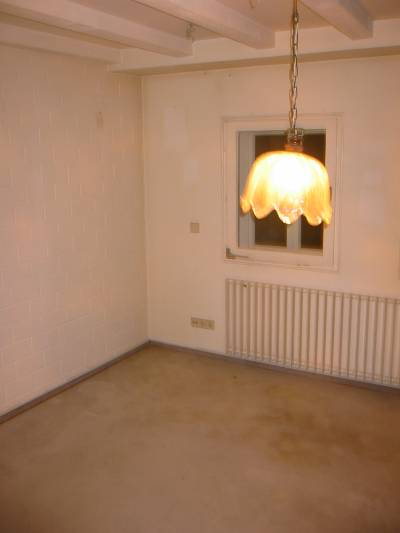 Photo of stained walls and carpet.